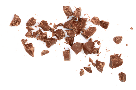 Chocolate pieces isolated on white. Top view. Flat lay.