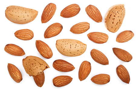 almonds isolated on white background. Top view. Flat lay pattern.
