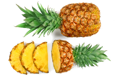 Sliced pineapple isolated on white background. Top view. Flat lay. Imagens