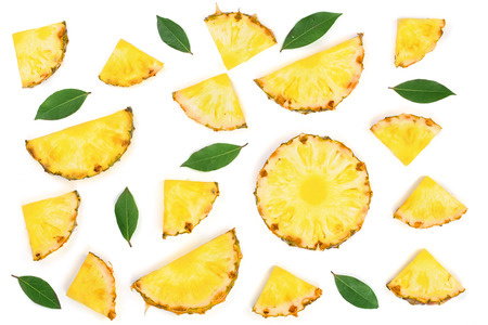 Sliced pineapple with green leaves isolated on white background. Top view. Flat lay pattern.