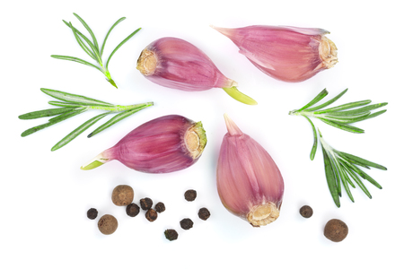 garlic with rosemary and peppercorn isolated on white background. Top view. Flat lay pattern. Stock Photo