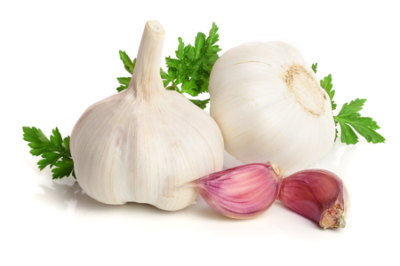 garlic with parsley leaf isolated on white background. Stock Photo