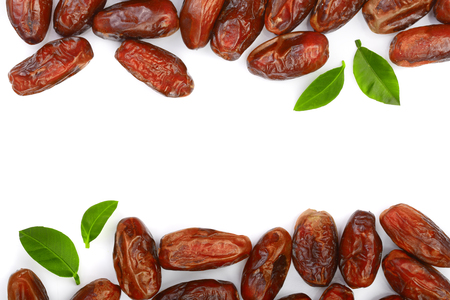 dry dates with green leaves isolated on white background with copy space for your text. Top view. Flat lay pattern.