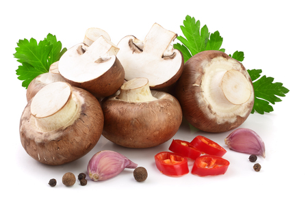 Royal Brown champignon with parsley, garlic and peppercorns isolated on white background. Stock Photo