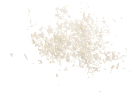Heap of coconut flakes isolated on white background