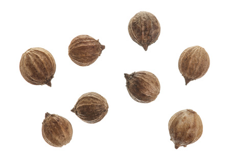 Coriander seeds isolated on white background top view Banque d'images