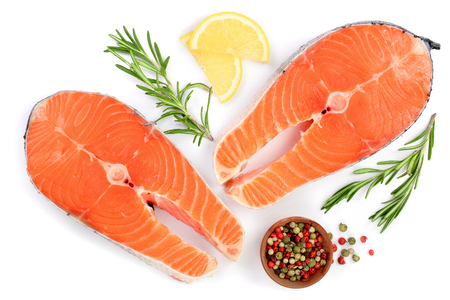 Slice of red fish salmon with lemon, rosemary and peppercorns isolated on white background. Top view. Flat lay. Foto de archivo
