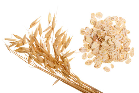 oat spike with oat flakes isolated on white background. Top view. Archivio Fotografico