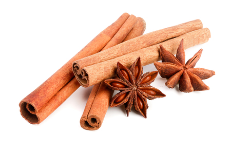 Cinnamon sticks and star anise isolated on white background. Top view.