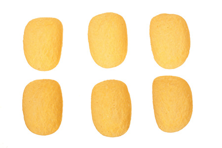 potato chips on white background close-up. Top view. Flat lay. Set or collection.