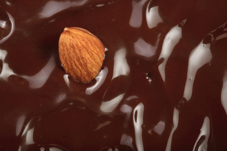 Melted chocolate swirl as a background closeup.