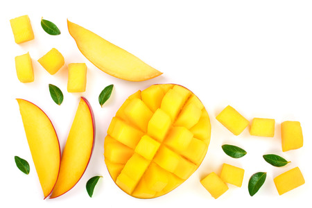 half of Mango fruit decorated with leaves isolated on white background close-up. Top view. Flat lay.