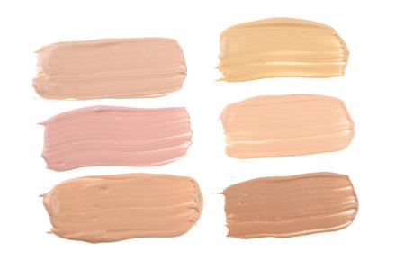 Beige liquid foundation makeup isolated on white background Stock Photo
