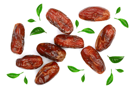dry dates decorated with leaves isolated on white background. Top view. Flat lay pattern.