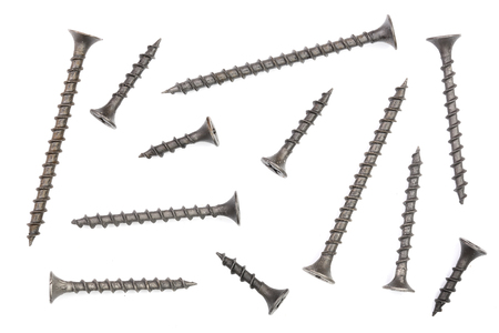 black screws isolated on white background closeup. Top view
