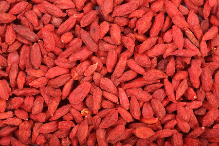Dried goji berries as a background close up.