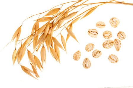 oat spike with oat flakes isolated on white background. Top view. Stok Fotoğraf