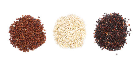 Black red and white quinoa seeds isolated on white background. Top view.