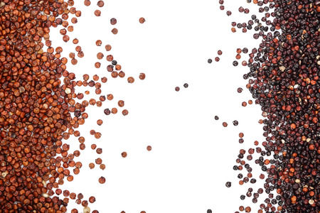 Black and red quinoa seeds isolated on white background with copy space for your text. Top view.