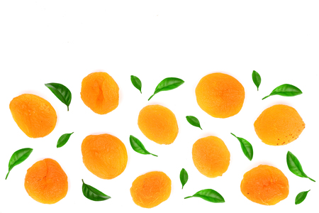 Dried apricots decorated with green leaves isolated on a white background with copy space for your text. Top view. Flat lay pattern. 스톡 콘텐츠