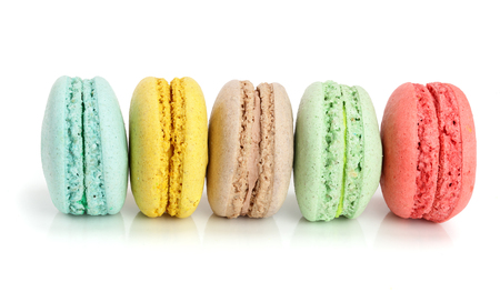 colorful macaroons isolated on white background closeup.