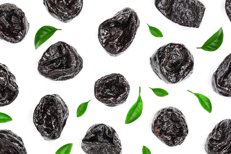 Dried plum - prunes decorated with green leaves isolated on a white background. Top view. Flat lay.