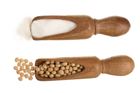 soybeans and dried soy milk in wooden scoop isolated on white background top view.
