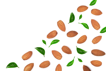 almonds decorated with leaves isolated on white background with copy space for your text. Top view. Flat lay pattern.