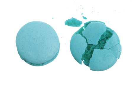 broken blue macarons isolated on white background closeup. Stock Photo