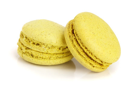 yellow macaroon isolated on white background closeup.