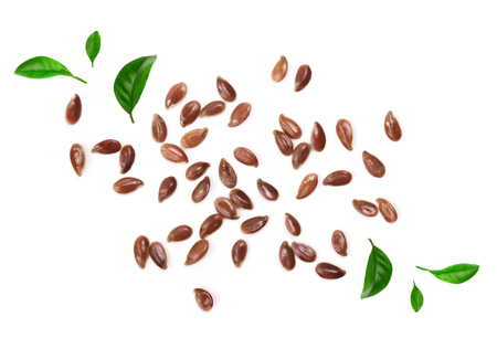 flax seeds decorated with green leaves isolated on white background. Top view.