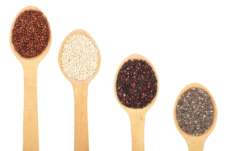 Black red white quinoa and chia seeds in wooden spoon isolated on white background with copy space for your text. healthy food. Top view.