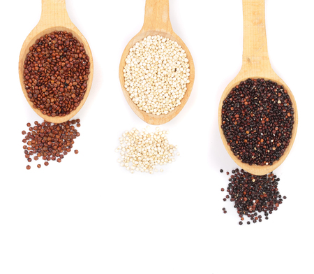 Black red white quinoa seeds in wooden spoon isolated on white background with copy space for your text. healthy food. Top view.