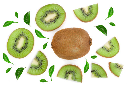 sliced kiwi fruit decorated with green leaves isolated on white background. Flat lay pattern. Top view.