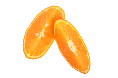 Two slices of tangerine isolated on white background. Top view. Flat lay.