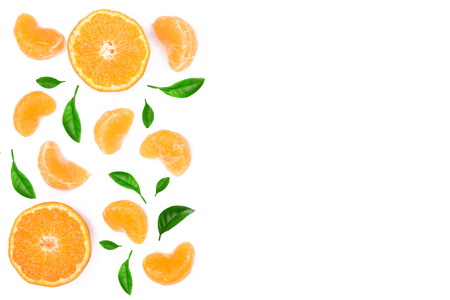 slices of mandarin or tangerine with leaves isolated on white background with copy space for your text. Flat lay, top view. Fruit composition.