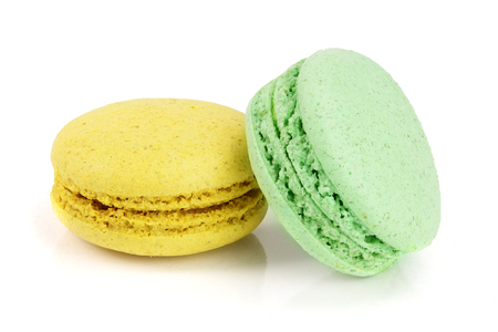 yellow and green macaroon isolated on white background closeup