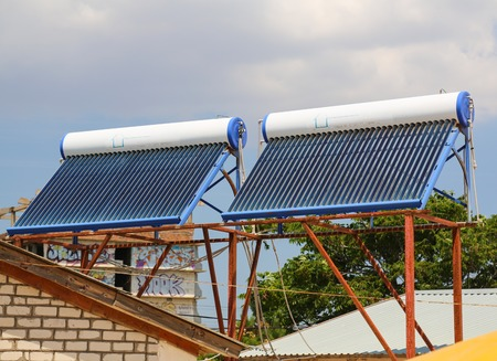 Vacuum solar cells for water heating system on the house roof