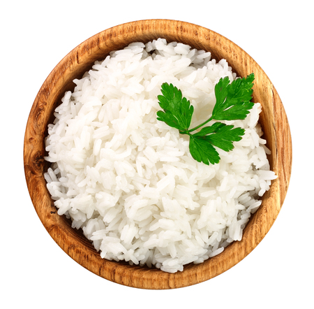 rice in a wooden bowl isolated on white background. Top view. Flat lay.