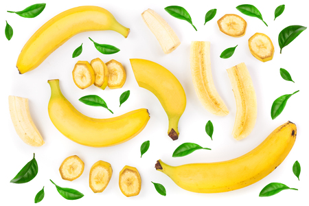 whole and sliced bananas decorated with green leaves isolated on white background. Top view. Flat lay