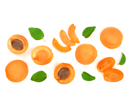 Apricot fruits with leaves isolated on white background with copy space for your text. Top view. Flat lay pattern. Stock Photo