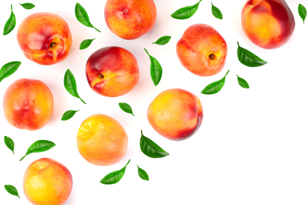 ripe nectarine with leaves isolated on white background with copy space for your text. Top view. Flat lay pattern. Фото со стока