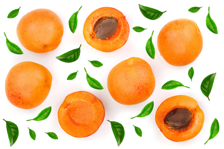 Apricot fruits with leaves isolated on white background. Top view. Flat lay pattern. Stock Photo