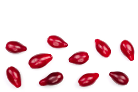 Red berries of cornel or dogwood isolated on white background with copy space for your text. Top view. Flat lay.