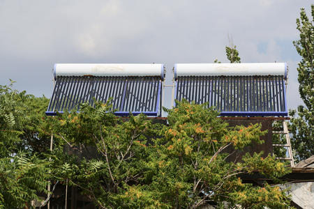 Vacuum solar cells for water heating system on the house roof.