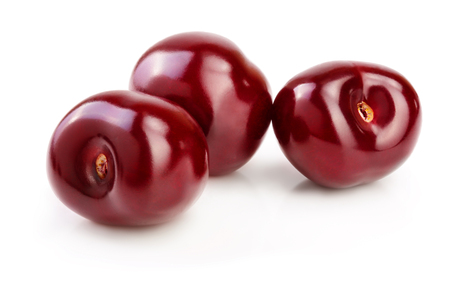 Sweet red cherries isolated on white background macro.