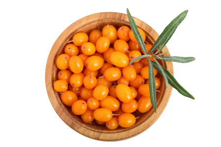 Sea buckthorn. Fresh ripe berry in woden bowl with leaves isolated on white background. Top view. Flat lay pattern. 版權商用圖片