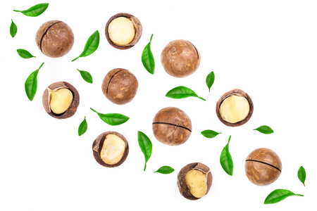 Shelled and unshelled macadamia nuts with leaves isolated on white background with copy space for your text. Top view. Flat lay pattern.