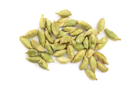 Green cardamom seeds isolated on white background. Top view. Flat lay. 写真素材
