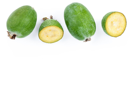 Tropical fruit feijoa Acca sellowiana isolated on white background with copy space for your text. Top view. Flat lay pattern Фото со стока